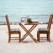 Romantic dinner for two served on a white sand beach — Stock Photo