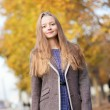 Outdoor autumn portrait of young beautiful lady — Stock Photo