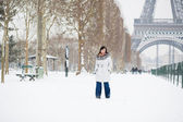 Beautiful girl walking by Champ de Mars at winter day — Stock Photo