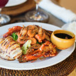Delicious grilled squid with seafood - Stock Photo