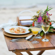 Romantic dinner served for two on a beach — Stock Photo