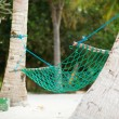 Palm trees and hammock on perfect white sand beach — Stock Photo