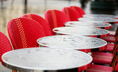 Round tables in a Parisian cafe under the rain — Stock Photo