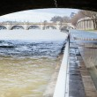 Seine is out of its banks under a Parisian bridge — Stock Photo #19947557