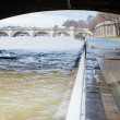 Seine is out of its banks under a Parisian bridge - Stock Photo