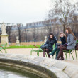 Three cheerful girls in Tuileries garden — Stock Photo #20046523