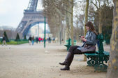 Girl sending sms or surfing in the net in Paris — Foto de Stock