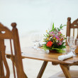 Table with flowers for romantic dinner for two — Stock Photo