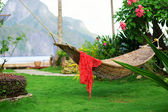 Hammock with red pareo on a tropical resort — Stock Photo