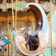 Young pretty girl on a Parisian merry-go-round - Foto de Stock  