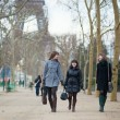 Three cheerful friends walking together in Paris - Foto de Stock  
