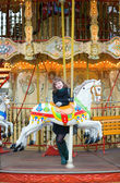 Young pretty girl on a Parisian merry-go-round — Stock Photo