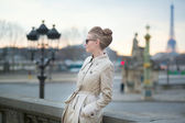 Elegant young Parisian woman outdoors — Stock Photo