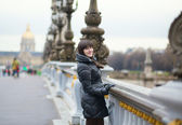Cheerful girl in Paris on a spring or winter day — Stock Photo