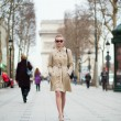 Young trendy Parisian woman in the street — Stock Photo #22462449