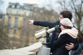 Tourists using telescope for sightseeing — Stock Photo