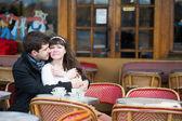Loving couple in a Parisian cafe — Stock Photo
