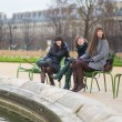 Friends in Tuileries park of Paris — Stock Photo #22809490