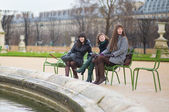 Friends in the Tuileries park of Paris — Stock Photo