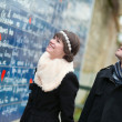 Couple near the I Love You wall in Paris — Stock Photo #22811596