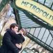 Happy couple under the Metro sign in Paris — Stock Photo