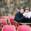 Dating couple in a Parisian outdoor cafe — Stock Photo