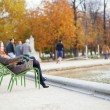 Girl enjoying beautiful autumn day in a park — Foto de Stock