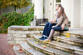 Dating couple sitting on the stairs — Stock Photo