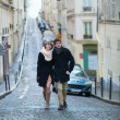 Young couple walking be the streets of Montmartre — Stock Photo