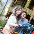 Royalty-Free Stock Photo: Beautiful couple on a merry-go-round