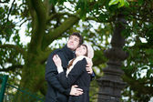 Happy young romantic couple hugging in park — Stock Photo