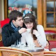 Couple drinking coffee in a cafe — Stock Photo #24240541
