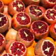 Many fresh pomegranates on market - Stok fotoğraf