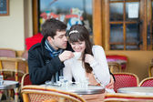 Couple drinking coffee in a cafe — Stock Photo