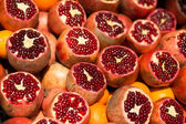 Many fresh pomegranates on market — Stock Photo