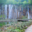 Waterfall and tourist path in Plitvice lakes park — Stock Photo