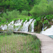cascades and tourist path in plitvice lakes park — Stock Photo