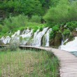 Stock Photo: Cascades and tourist path in Plitvice lakes park