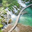 Stock Photo: Wooden tourist path in Plitvice lakes park
