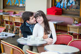 Dating couple in a cafe — Stock Photo