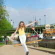 Happy girl jumping on the embankment — Stok fotoğraf