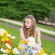 Girl with beautiful orange and yellow poppies — Foto de Stock