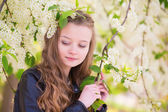 Portrait of a beautiful girl with blooming tree — Stock Photo