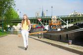 Beautiful young girl walking in Paris — Stock Photo