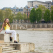 Stock Photo: Thoughtful girl on Seine embankment