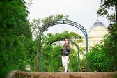 Happy girl walking in a beautiful park — Stock Photo