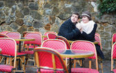 Dating couple in an empty cafe — Stok fotoğraf
