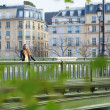 Girl in Paris on a bridge — Stock Photo