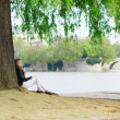 Girl reading under a tree near Seine — Stock Photo