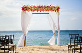 Beautiful wedding arch on the beach — Stock Photo
